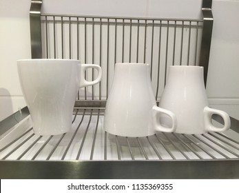 Three White and clean cup of coffee keep on stainless shelf in kitchen