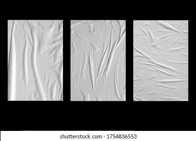 Three white crumpled sheets of paper on a black background.