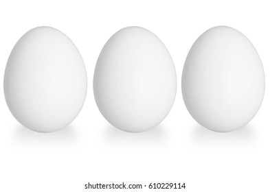 three white eggs isolated on the white background