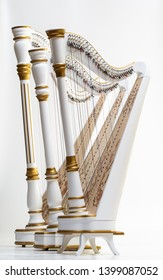 Three white harps with gilding, painting and carving, white isolated background