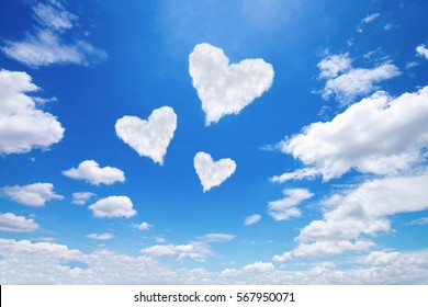 it is three white heart shaped clouds on blue sky.