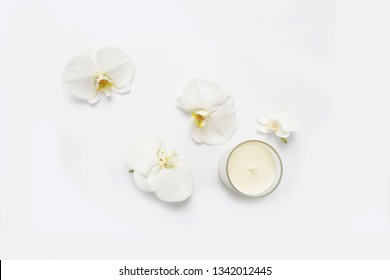 Three white orchid and white candle on white background