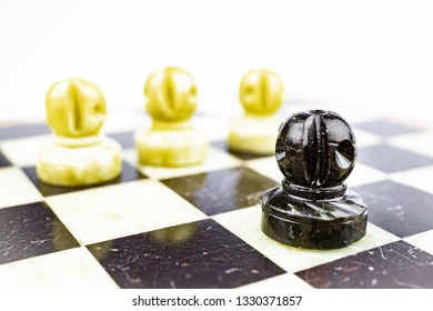 Three white pawns pursuing a black pawn on the chessboard