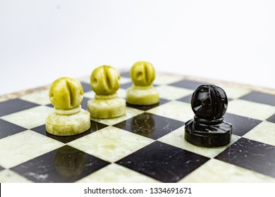 Three white pawns pursuing a black pawn