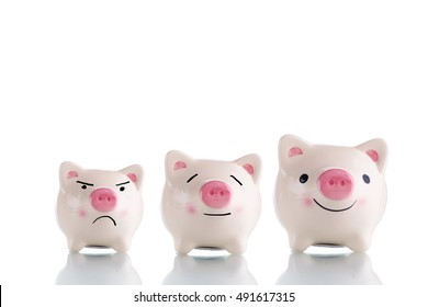 Three white piggy bank with different size small, medium and large and different emotion sad, calm and happy - saving, emotional and investment