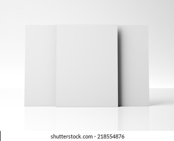 three white posters near white wall with reflections