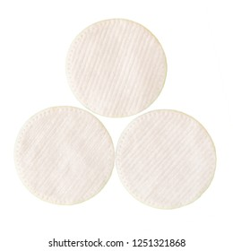 Three white wadded disks for removal of a make-up. Isolate on white background.