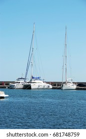 Three white yacht on the dock in the Bay on the black sea in Bulgaria in the resort