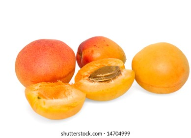 Three whole apricots and one apricot is broken