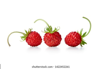 Three wild strawberries on white background.