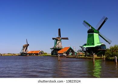 Three wind mills on lake