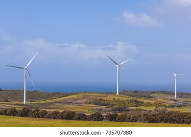 Three wind turbines in agricultural fields in Australia