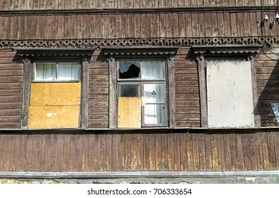 three Windows of an old house with broken glass