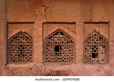 Three windows with wooden lattices. Abyaneh, an old mountain village near Kashan. Iran.