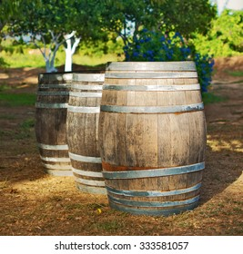 Three wine barrels in the garden.