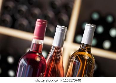 Three wine bottles in a tasting room