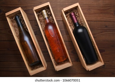 Three Wine Boxes: Blush, Cabernet and Chardonnay wine bottles in individual cases with packing straw.