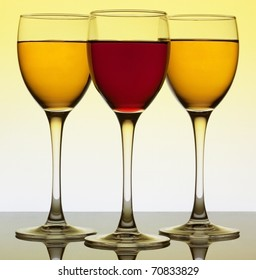Three wine glass over yellow background