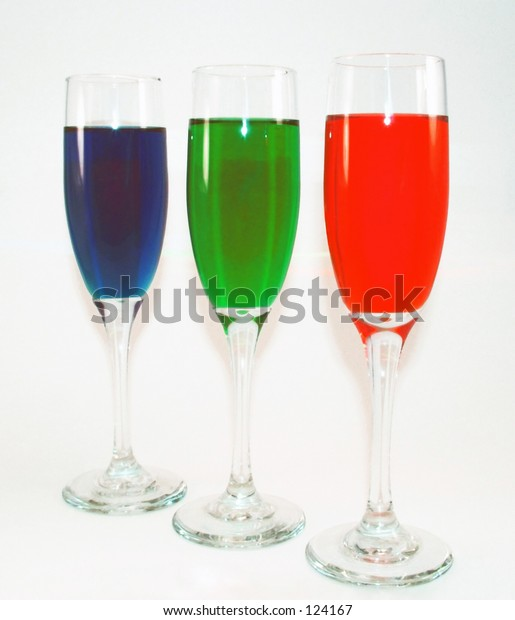 Three wine glasses filled primary colors.