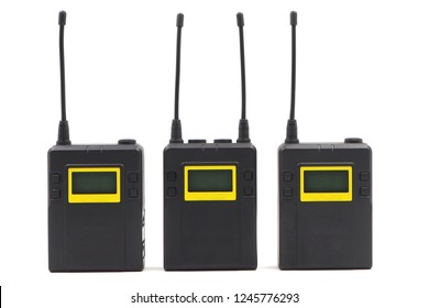 Three wireless microphone transmitter and reciever  isolated on white background