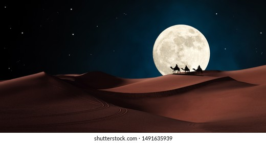 Three wise men riding on camels traveling in the desert. Biblical magi concept.