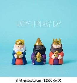 the three wise men and the text happy epiphany day on a blue background