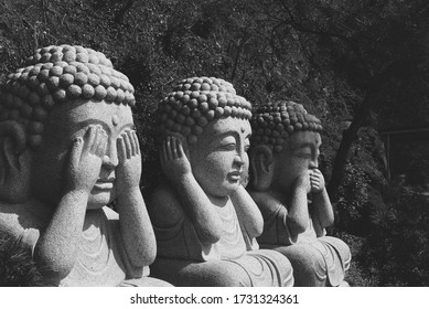 Three wise monkeys. Buddhist statue in South Korea.