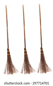 Three witches broomsticks isolated on a white background