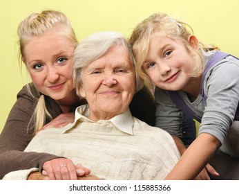 Three woman - three generations on white. MANY OTHER PHOTOS WITH THIS FAMILY IN MY PORTFOLIO. MANY OTHER PHOTOS WITH THIS FAMILY IN MY PORTFOLIO.