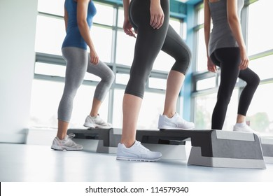 Three women in aerobics class in gym