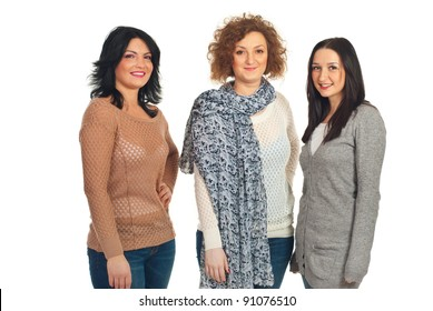 Three women with different hairstyles standing in a line and smiling isolated on white background