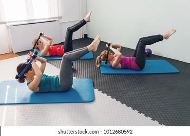 Three women doing Pilates exercising