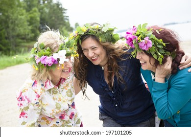 Three women laughing together, Nykoping, Sodermanland, Sweden