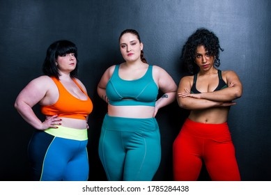 Three women making sport and fitness. Studio portraits about lifestyle and self acceptance