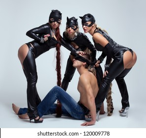 Three women and man playing sexual game