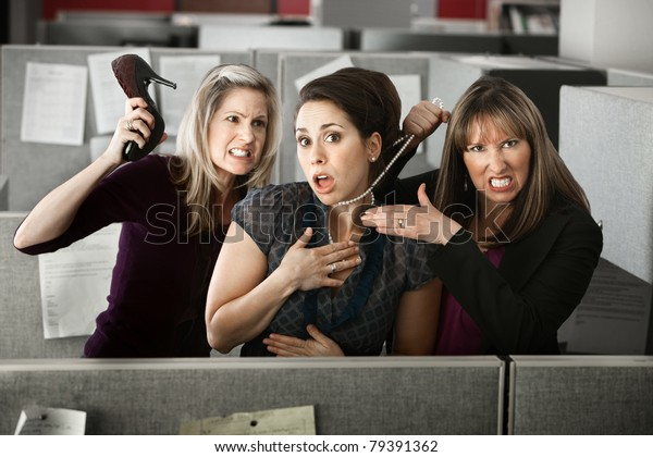 Three women office workers quarrels in cubicle