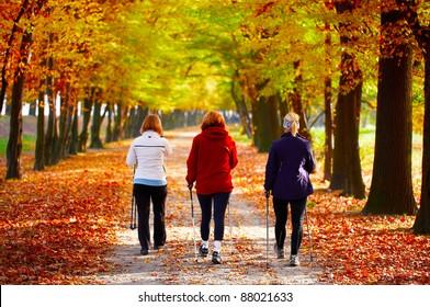 Three women in the park - Nordic walking
