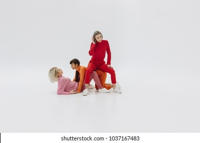 three women posing on white background
