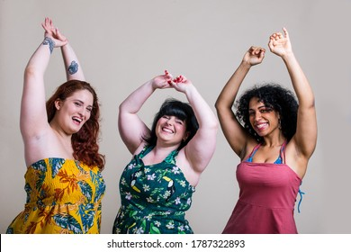 Three women posing for studio portraits. Celebrating and having fun. Concept about lifestyle and body positivity