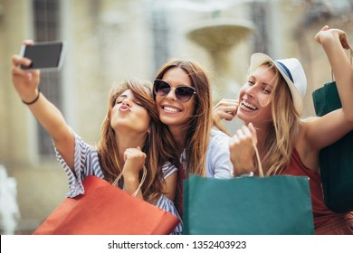 Three women shopping together and make selfie photo