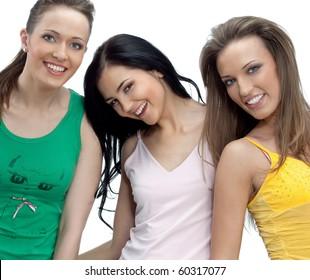 Three women smiling on white background