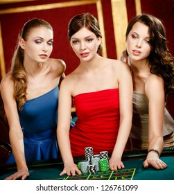 Three women stake playing roulette at the casino