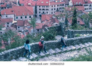Three women walking along the stone steps in a beautiful European city
