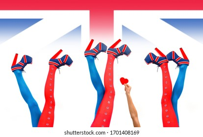 Three women's legs are stretched out high in a vertical  form in front of a Union Jack background. They  wear high heels with a British flag pattern on them. A woman's arm stretches out with a red he