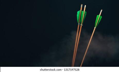 Three wood arrow. Beautiful  smog background. Medieval weapons are handmade.