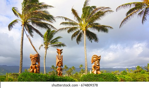 Three wood carvings of Polynesian tiki gods