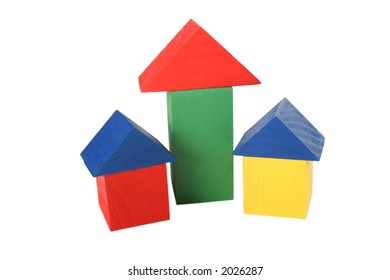 three wood toy houses