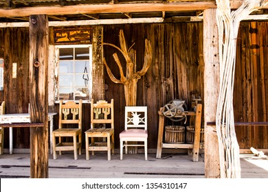 Three Wooden Chairs on the Front Porch of an Old Time Store in the Old West
