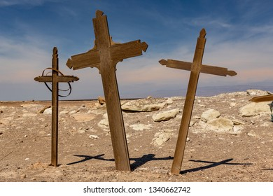 Three Wooden Crosses in an Abandoned Cemetery in the Atacama Desert, Northern Chile. From the era of nitrate mining
