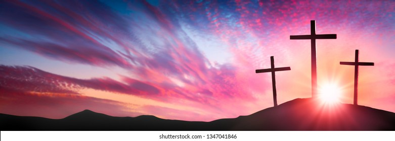 Three Wooden Crosses On Calvary's Hill At Sunrise - Crucifixion And Resurrection Of Jesus Christ Concept